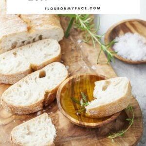 Homemade Italian Bread recipe; a sliced loaf of homemade Italian bread on a wooden serving platter.