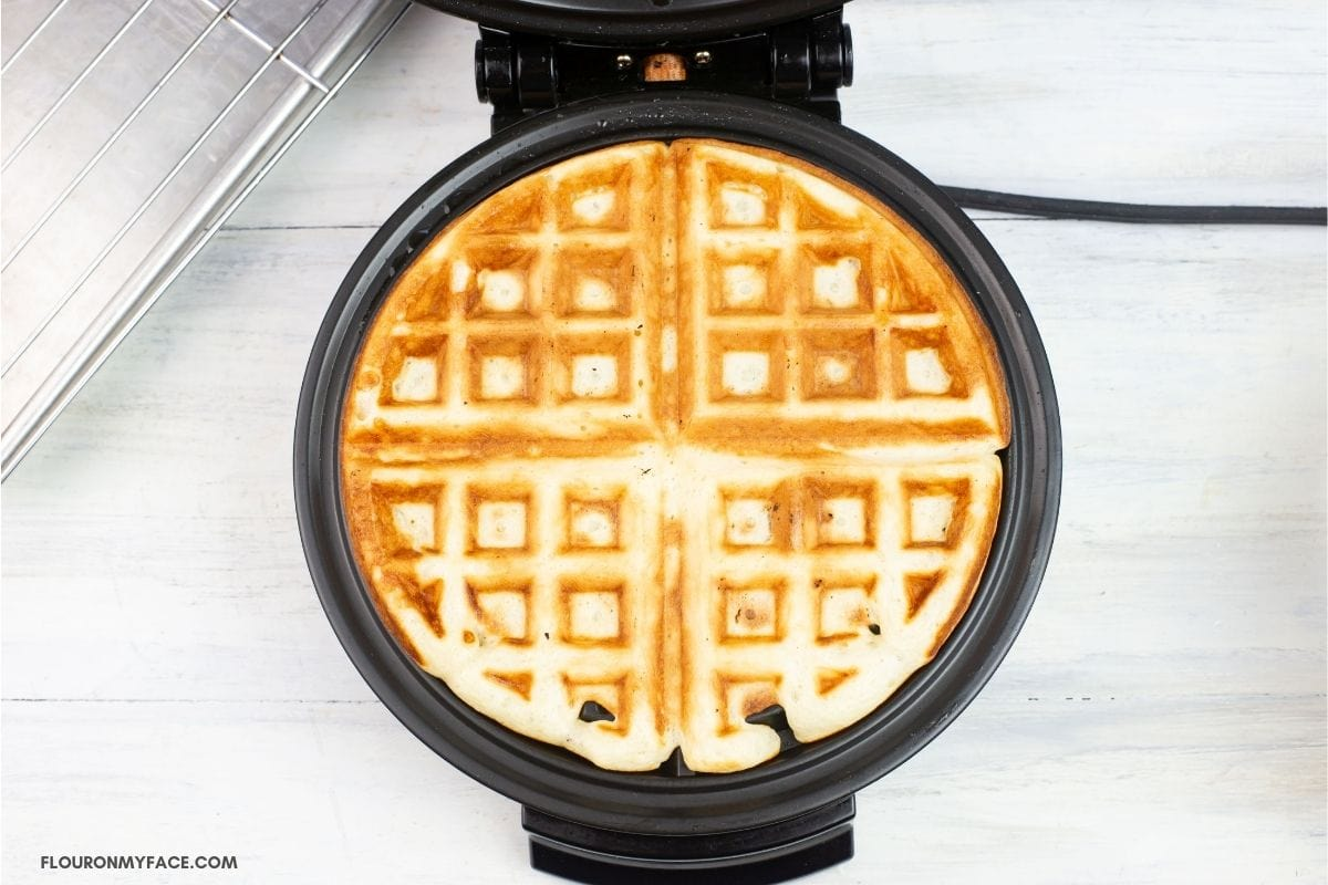 Golden brown waffle in a waffle iron.