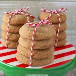 3 stacks of homemade Big soft ginger cookies on a holiday dessert stand