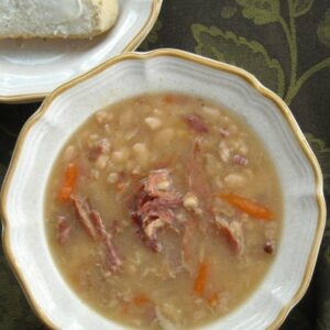 A bowl of ham and white bean soup.