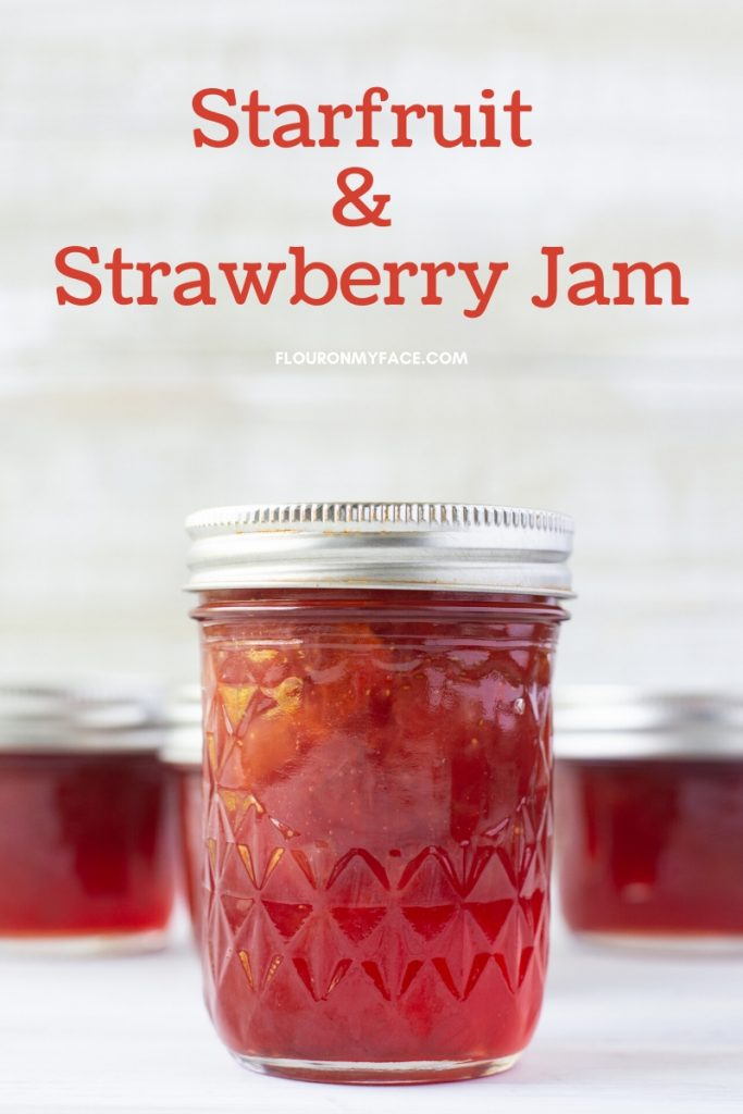Half pint canning jars filled with homemade Starfruit and Strawberry Jam