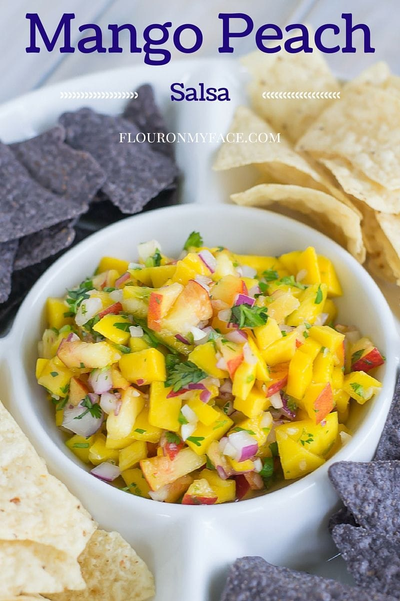 Take advantage of the ripe fruits of summer and enjoy this easy Mango Peach Salsa recipe which is perfect served with chips or served with grilled chicken or fish via flouronmyface.com