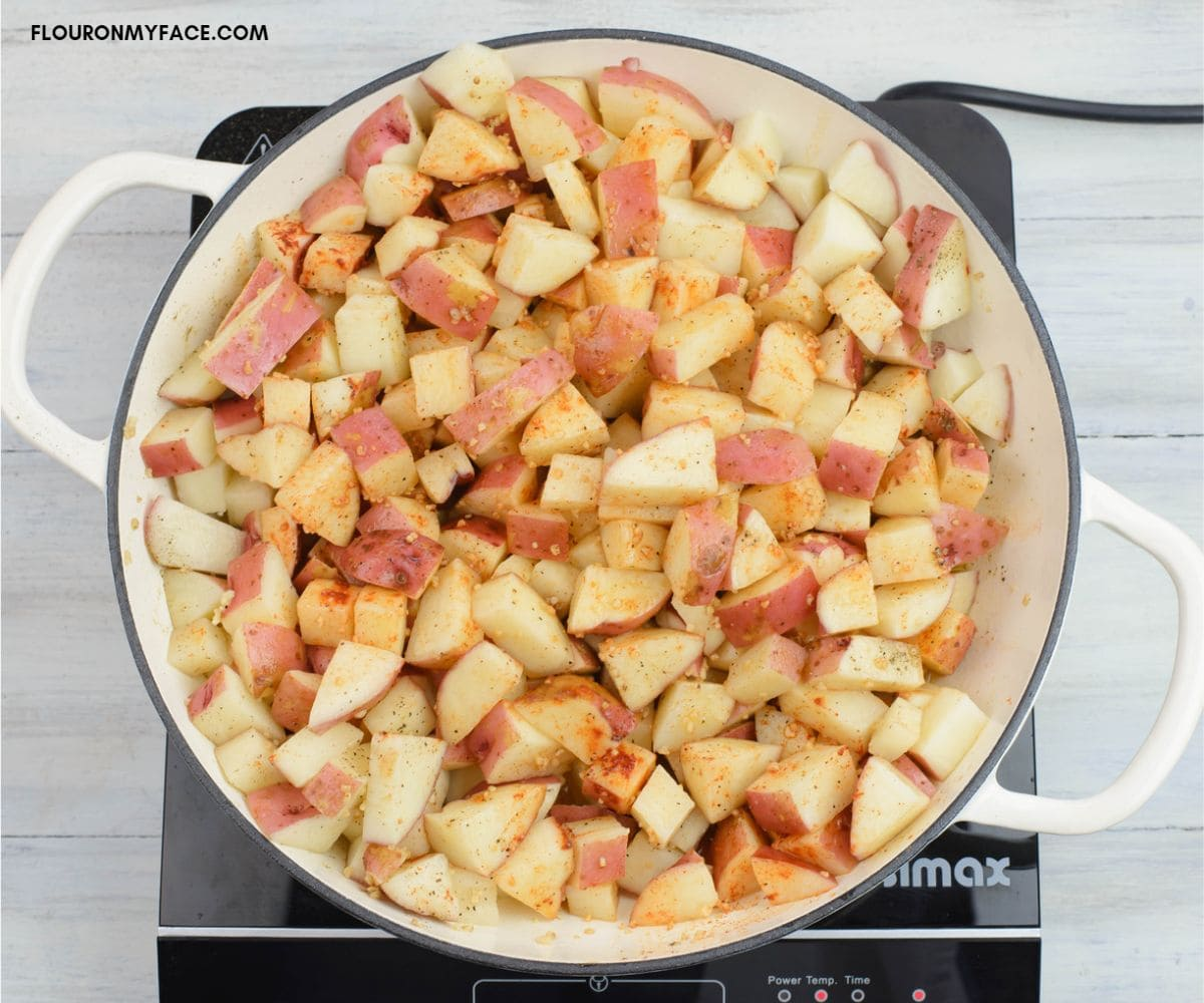 Cooking garlic potatoes on the stove.