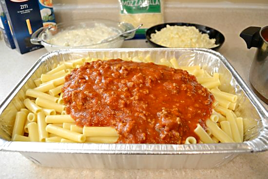 Baked Ziti Adding Sauce to cooked Ziti noodles
