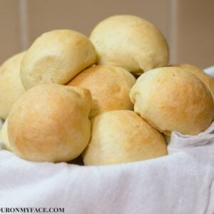 No Knead Slider Buns in a bread basket.