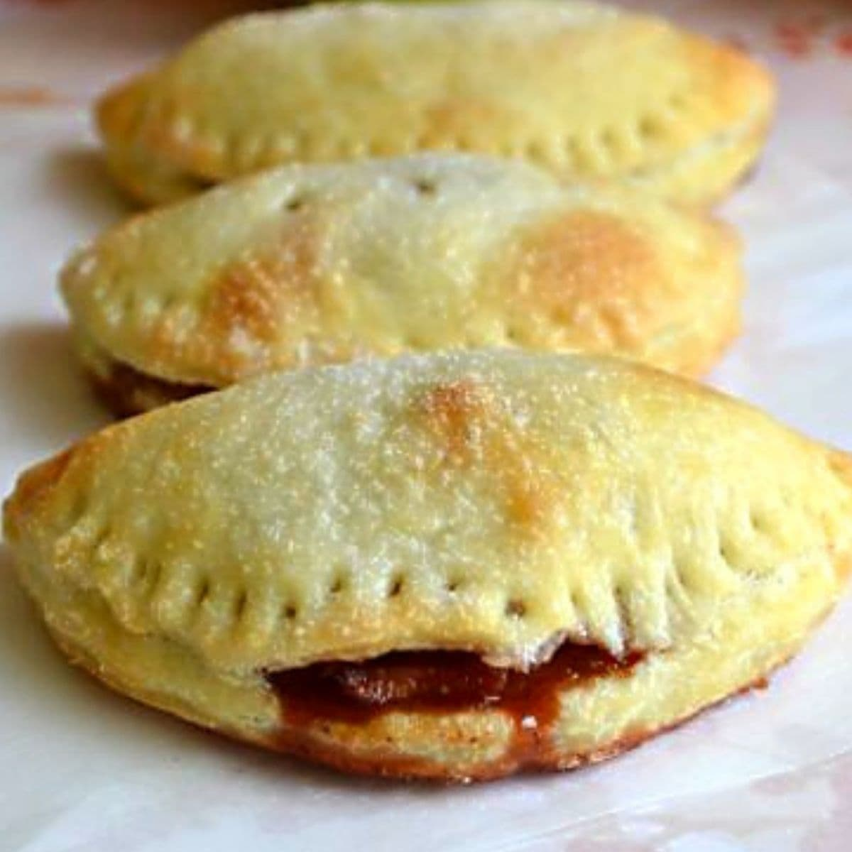 Three cranberry apple turnovers in a row.