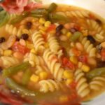 a bowl of crock pot vegetable and pasta soup