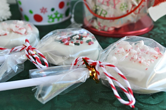 Christmas Oreo Cookie Pops wrapped in plastic for easy party favors or homemade holiday gifts.