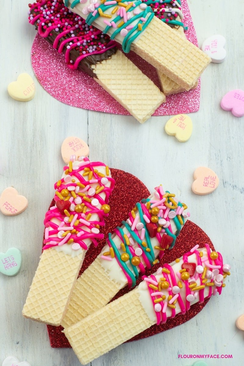 Close up of Valentines Day Chocolate dipped wafer cookies decorated with holiday sprinkles.