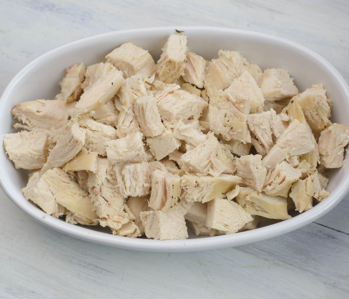 Diced chicken in a small oval bowl.