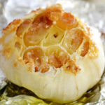 Roasted garlic head wrapped in aluminum foil