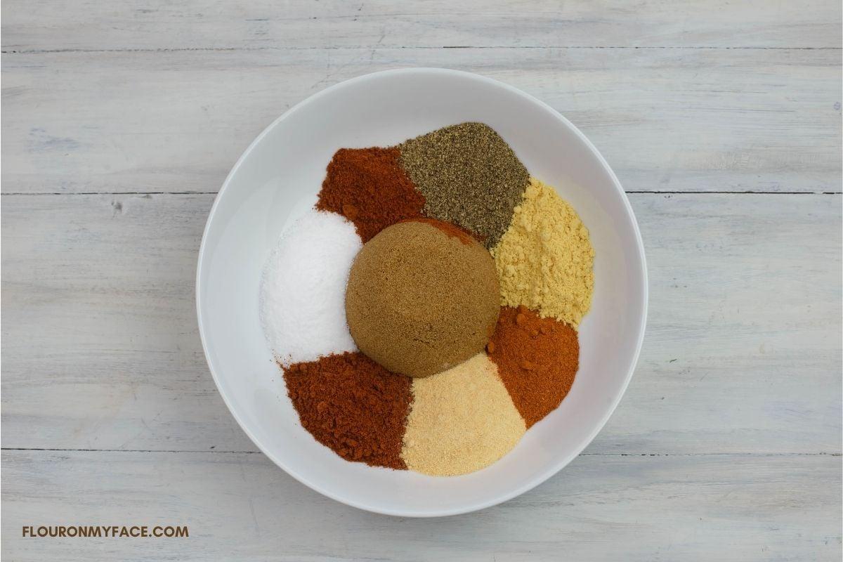 Dry pork rub spices in a white bowl.