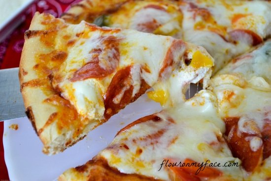 Easy homemade pizza crust via flouronmyface.com