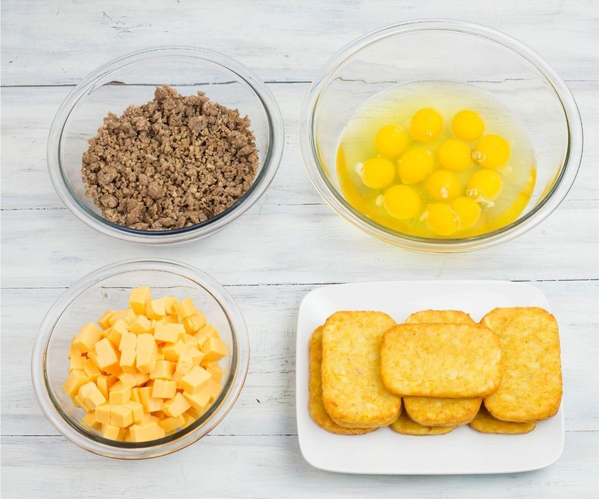 Velveeta breakfast casserole ingredients in bowls.