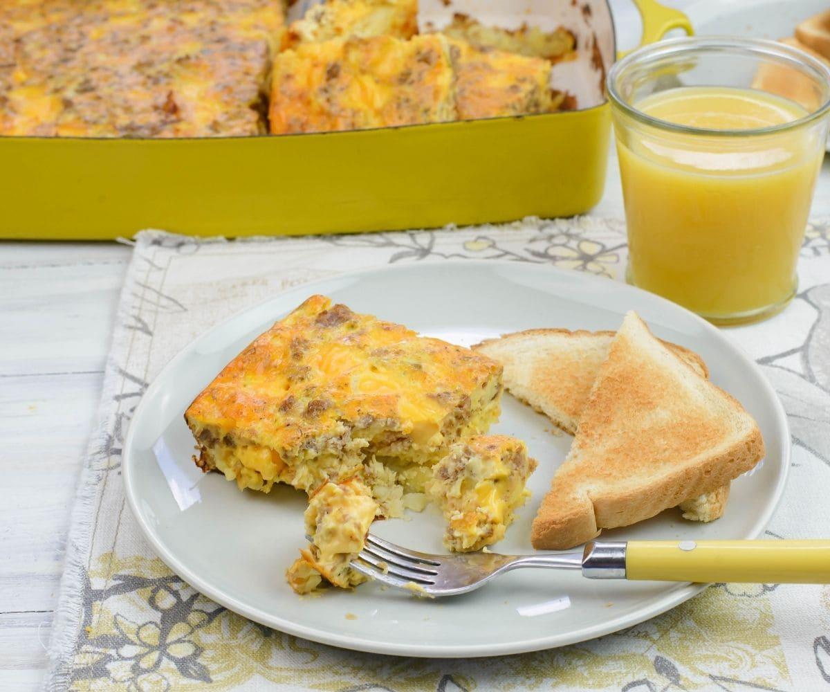 A square piece of Velveeta Breakfast Casserole on a plate with toast.