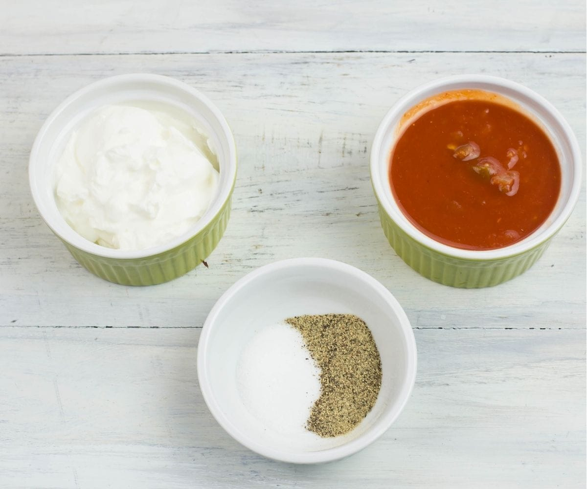 Individual bowls os sour cream, salsa, salt and pepper.