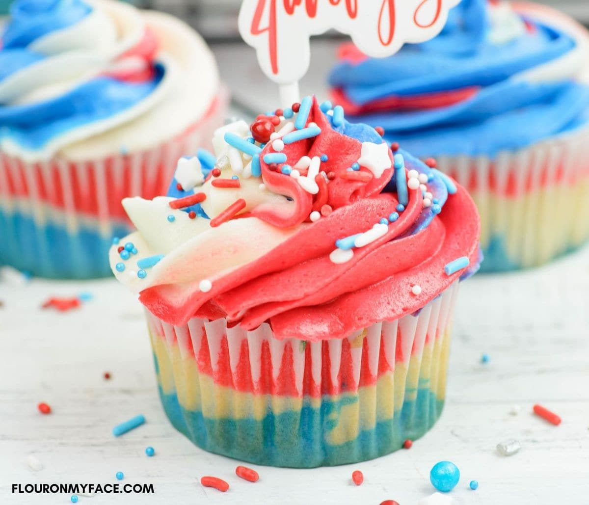 Closeup image of red, white and blue cupcakes decorated for the fourth of July.