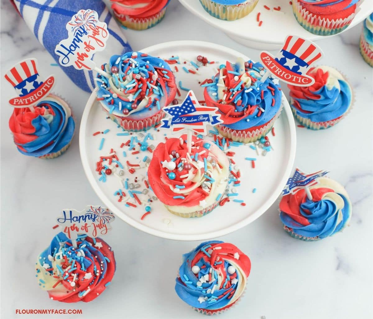 Overhead image of multi colored cupcakes to serve for the fourth of July.