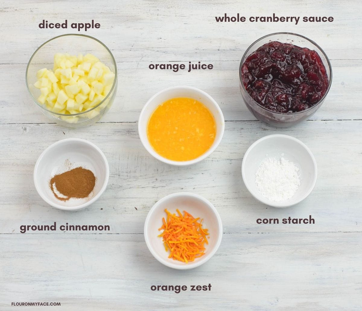 Apple and Cranberry Compote ingredients in individual bowls.