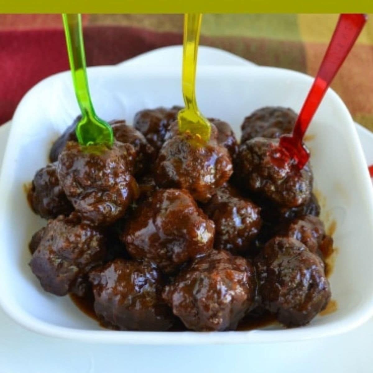 Grape Jelly Meatballs with appetizer forks.