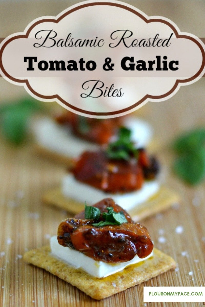 Roasted Balsamic Tomato Garlic Bites appetizer on a wooden serving platter for a party.