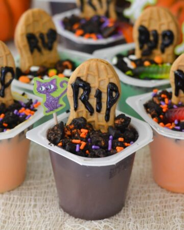 Graveyard Pudding Cups lined up on the counter.