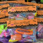 Halloween goodie bags decorated with a fun Halloween bag topper.