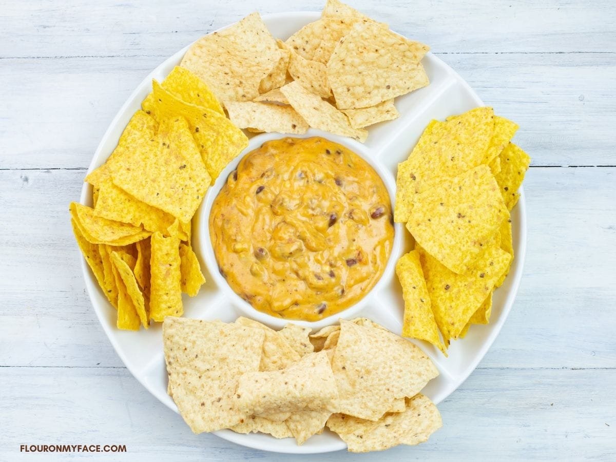 Cheesy Dip in a chip and dip serving plate.
