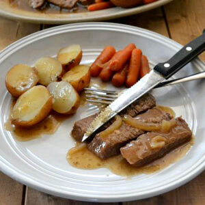 Crock Pot London Broil, potatoes and carrots on a plate