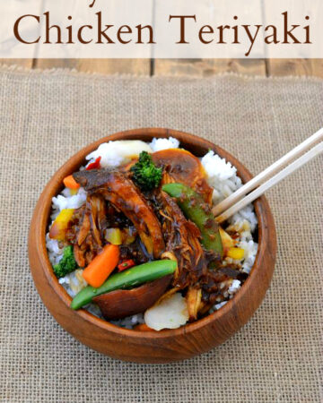 Crock Pot Chicken Teriyaki served over rice in a wooden bowl.