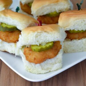 White serving plate with Butterfly Shrimp Sliders.