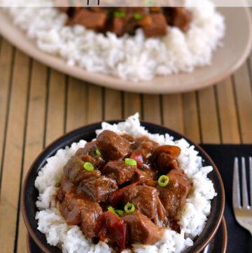 Crock Pot Pepper Steak recipe served over white rice.