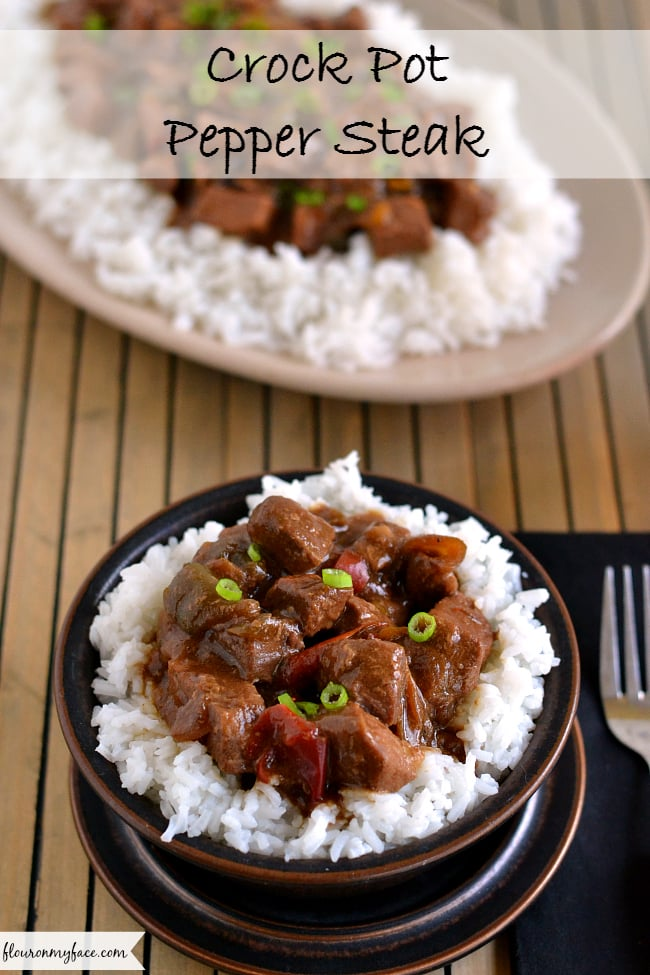 Crock Pot Pepper Steak recipe served over white rice.
