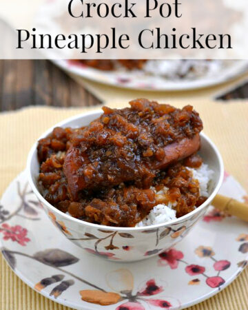 Crock Pot Pineapple Chicken served over rice in a bowl.