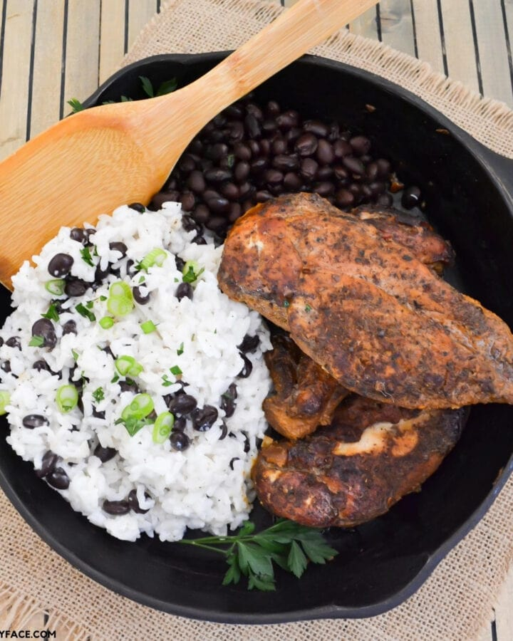Crock Pot Jamaican Jerk Chicken with coconut rice and black beans served in a cast iron skillet
