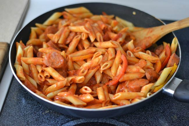 Mixing sauce with the pasta and Italian Sausage for this easy skillet meal via flouronmyface.com