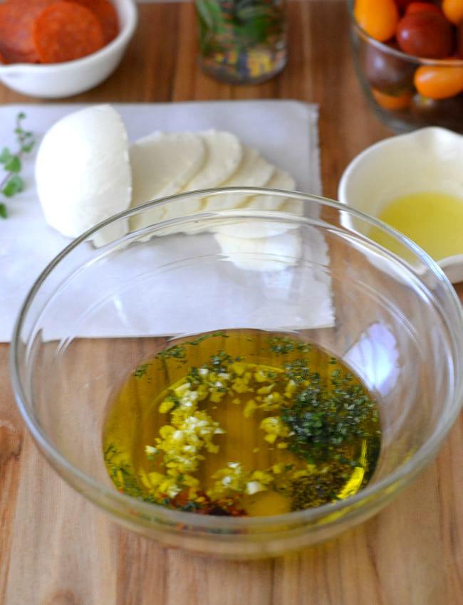 Mixing Bruschetta herbs #shop via flouronmyface.com