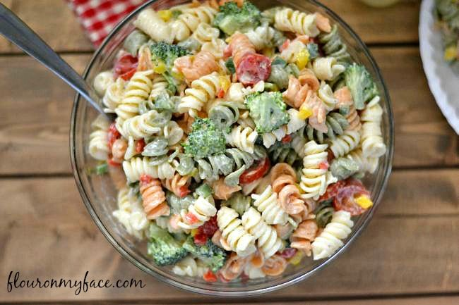 This Broccoli and Tomato Pasta Salad recipe is perfect for a summer picnic or backyard bbq side dish via flouronmyface.com