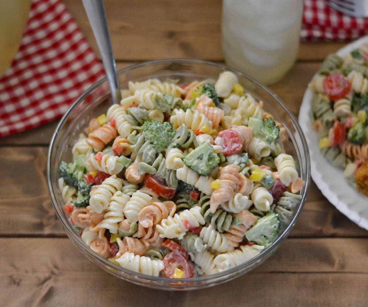 Broccoli and fresh tomato pasta salad in a serving bowl.