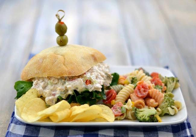 Rotisseria Chicken Salad recipe served on a ciabatta bun with a pasta salad via flouronmyface.com