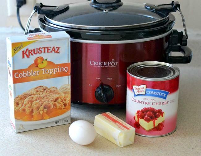 Easy Crock Pot Cherry Cobbler served over vanilla ice cream via flouronmyface.com