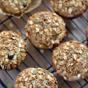 Freshly baked Oatmeal Granola Muffins on a cooling rack via flouronmyface.com