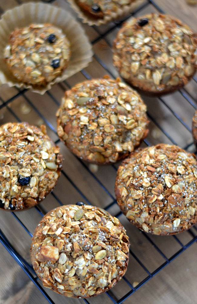 Freshly baked Oatmeal Granola Muffins on a cooling rack via flouronmyface.com #SplendaSweeties #SweetSwaps