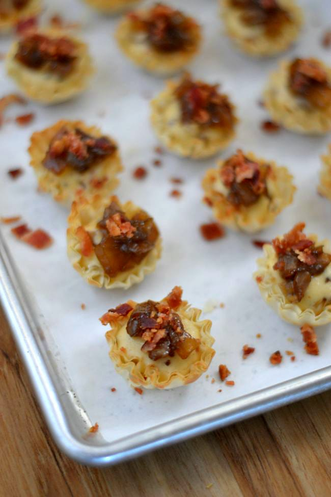 Mini Savory Cheesecake Appetizers baked on a cookie sheet via flouronmyface.com #SweetSwaps  #SplendaSweeties