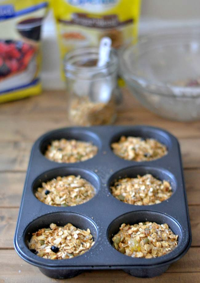 Top Oatmeal Muffin batter with more granola before baking via flouronmyface.com #SplendaSweeties #SweetSwaps