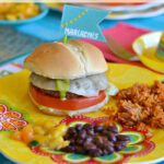 Chimichurri Turkey Burgers on a festive plate served with black beans