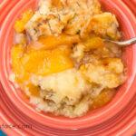 Crock Pot Peach Cobbler with a homemade cobbler topping via flouronmyface.com