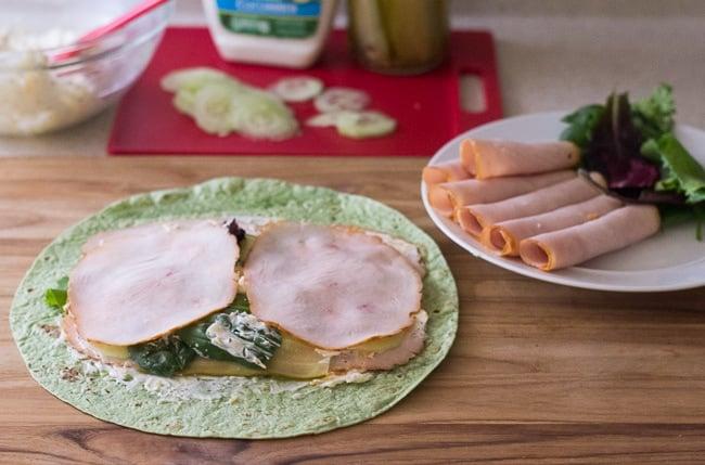 Assembling a Cucumber Ranch Turkey Wrap via flouronmyface.com