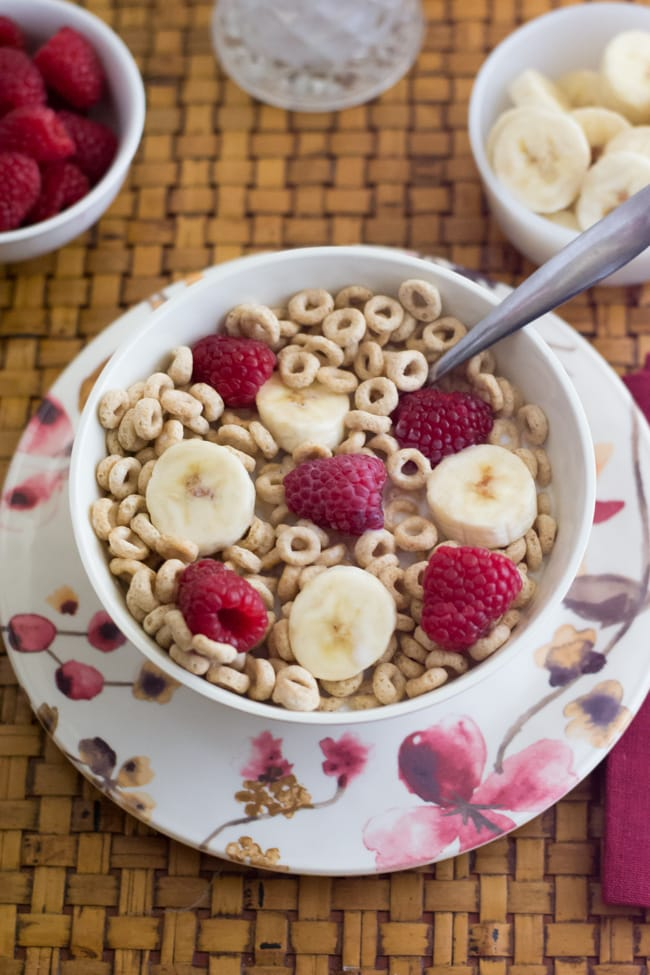Cheerios with sliced banana and raspberries via flouronmyface.com #shop