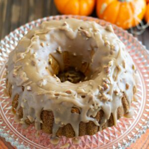 Overhead view of Pumpkin Pecan Bundt cake served on a vintage glass cake stand.